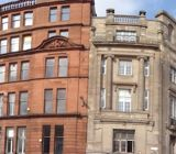 A panoramic of the are surrounding Glasgow Cross