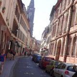 Streets of Strasbourg with la Cathédrale Notre Dame de Strasbourg in the background